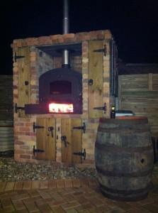 Wood fired oven in outdoor brick setting